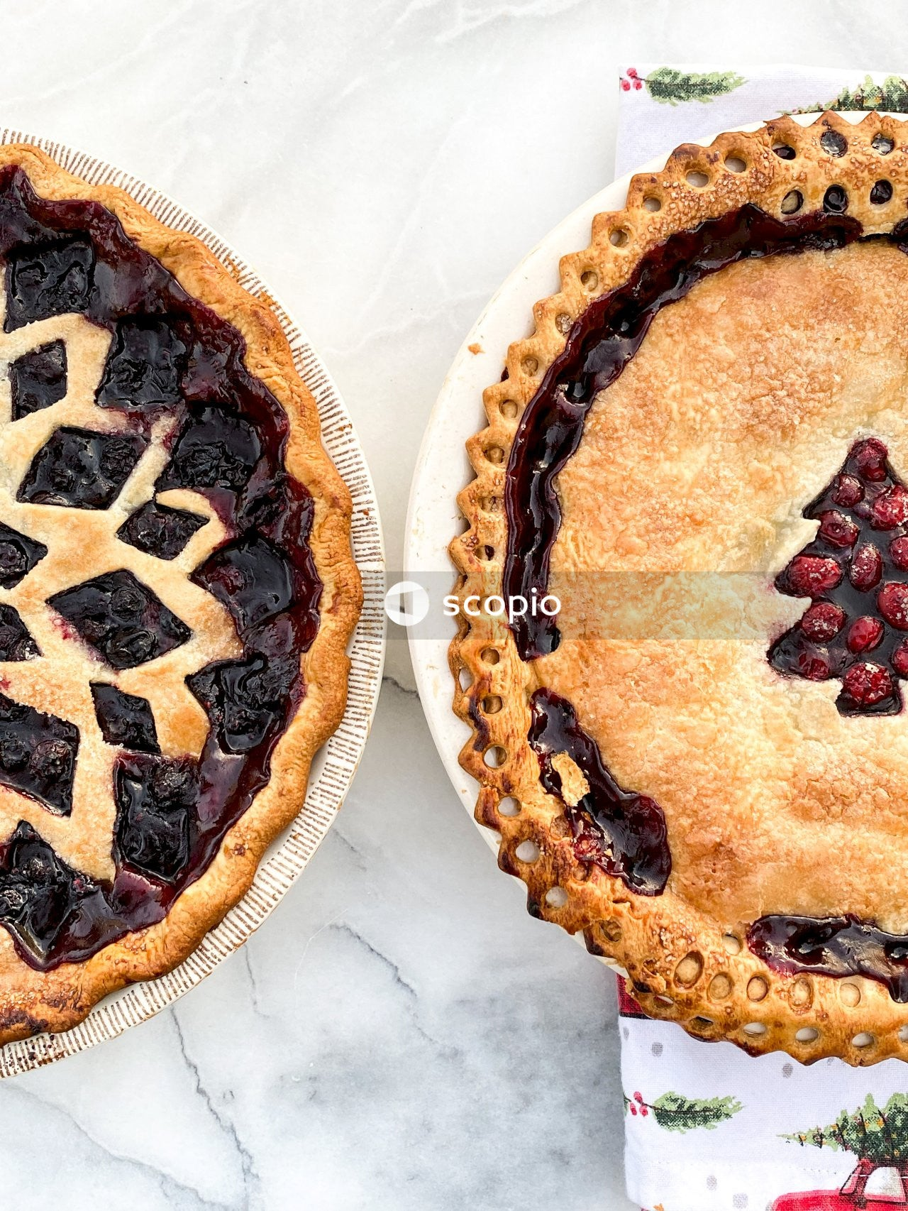 Pie with red and black berries on top