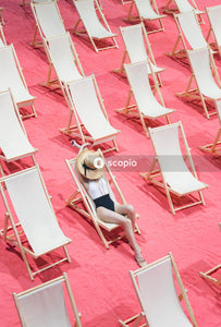 Woman sitting on the beach chair