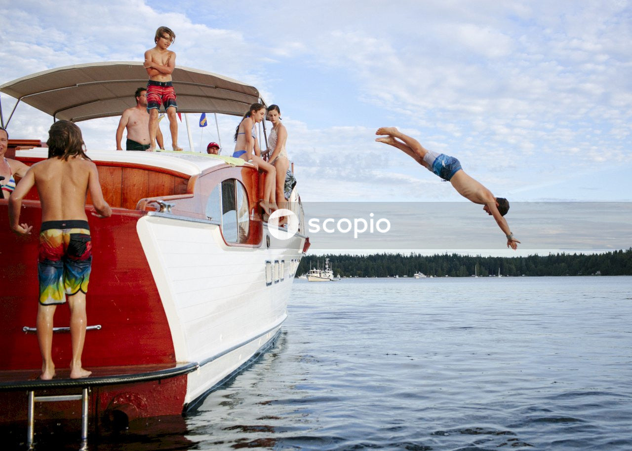 Person jumping from yacht in the lake