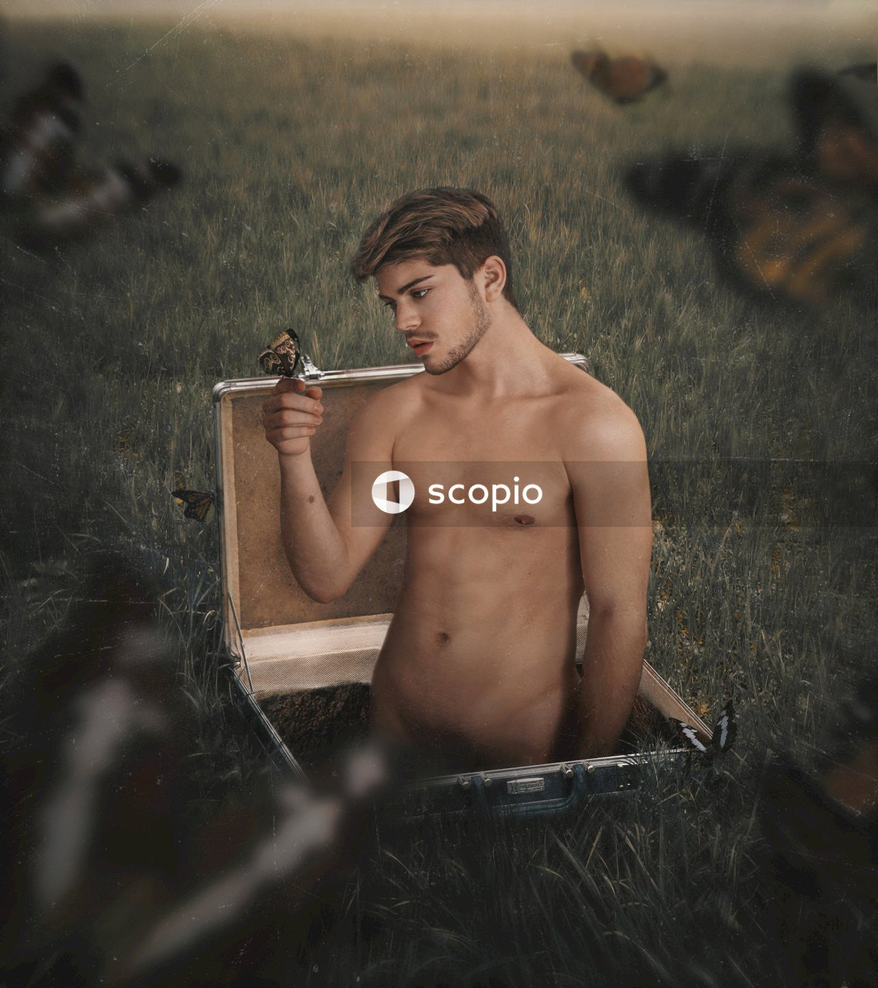 Topless man sitting on brown wooden chair
