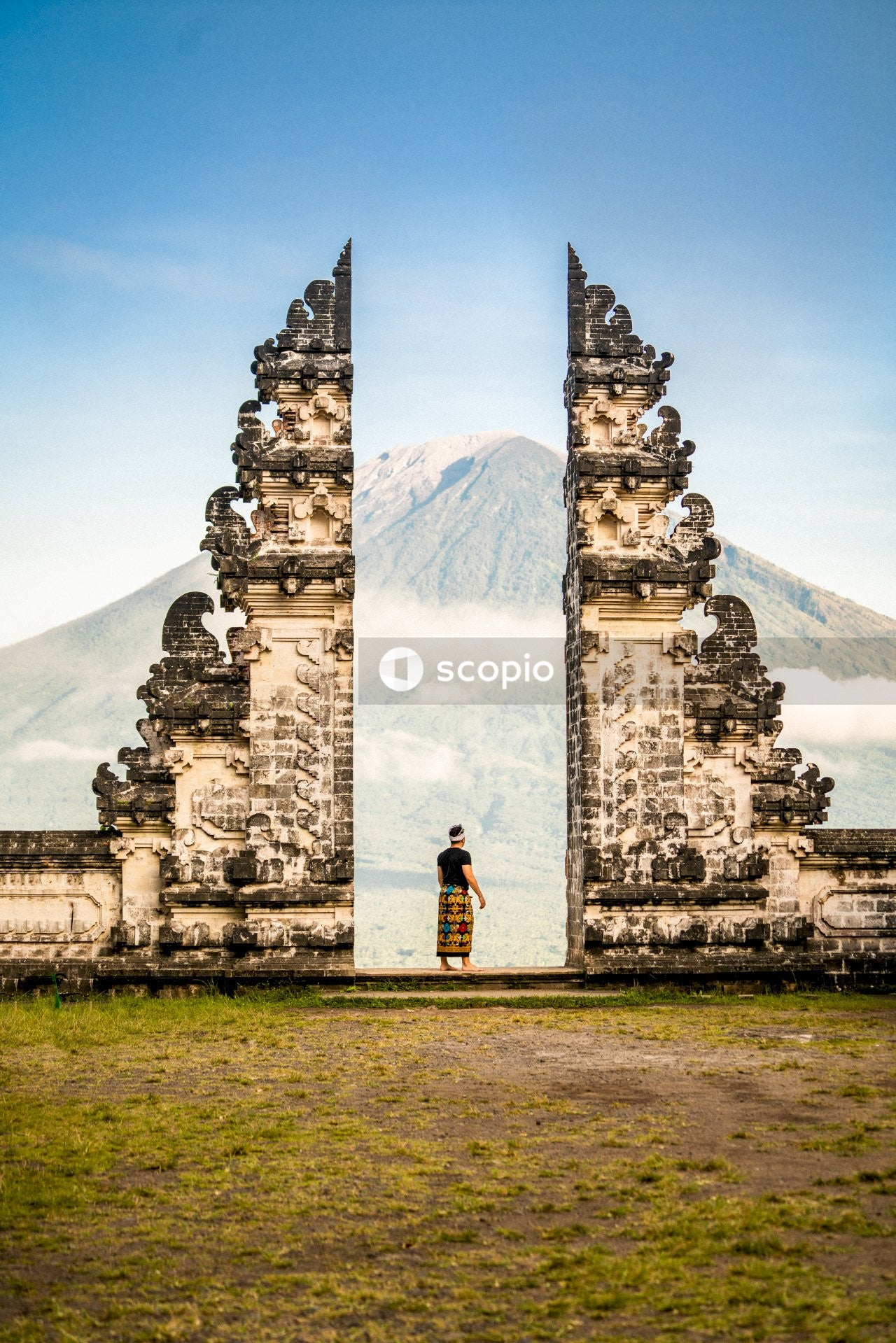 Man standing between temple Pura Penataran Agung Lempuyang, Indonesia