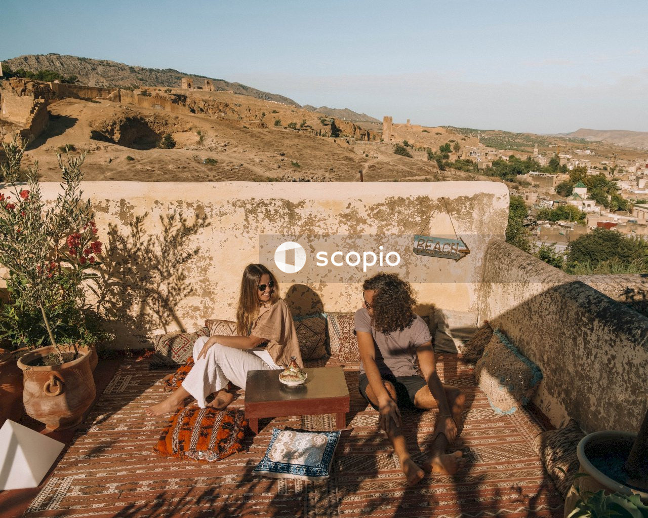 2 women sitting on brown wooden chair