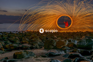 Time lapse photography of man holding firework