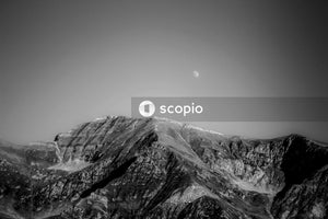 Grayscale photo of mountain range