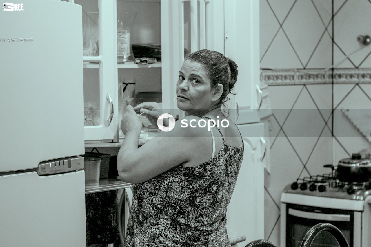 Woman in kitchen looking back
