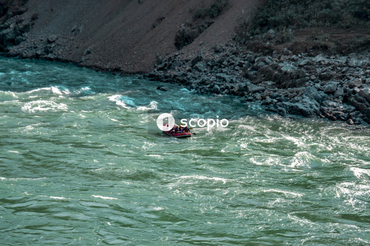 Red and black kayak on blue water