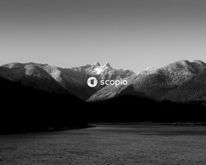 Grayscale photo of mountains and lake