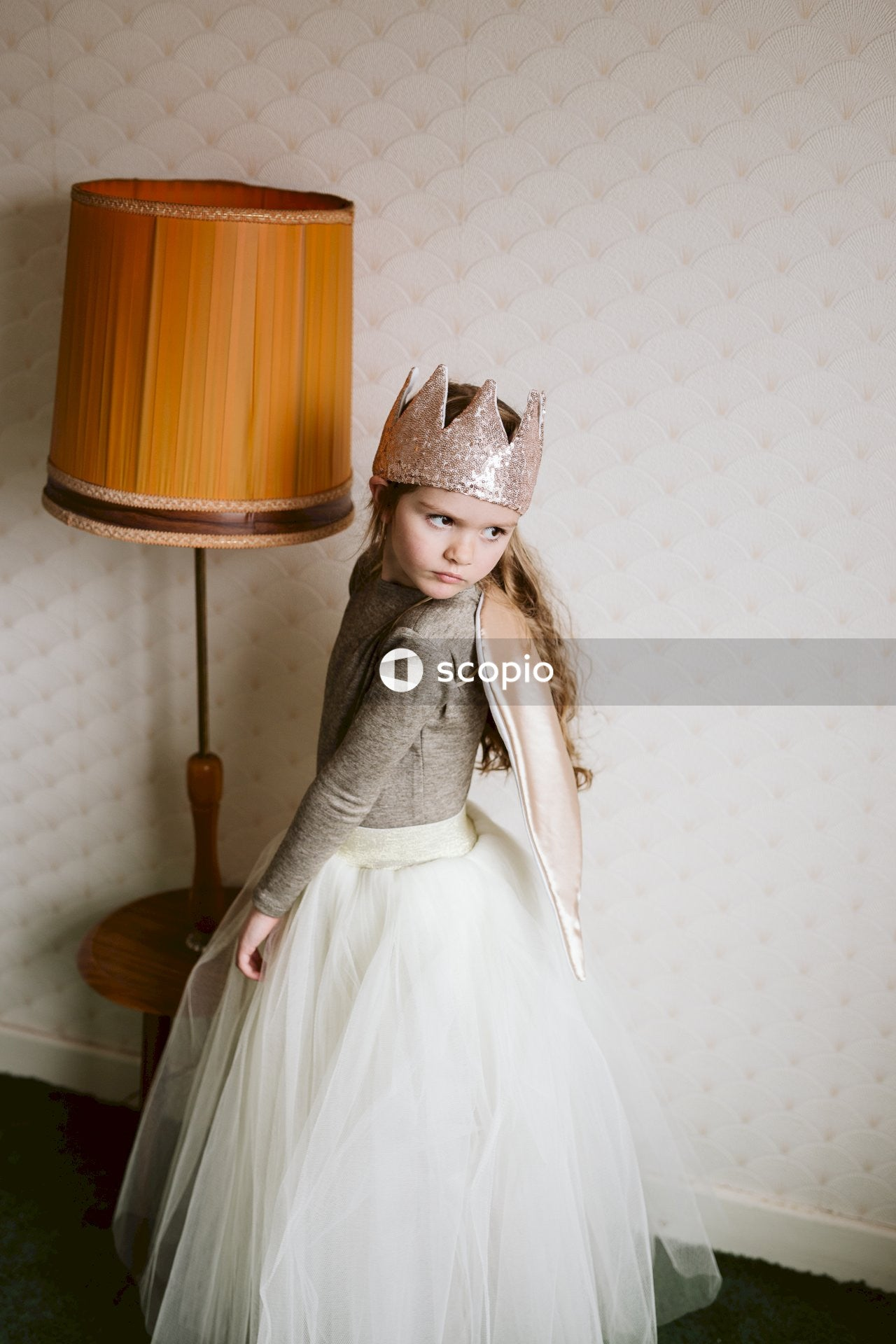 Girl in white dress wearing gold crown