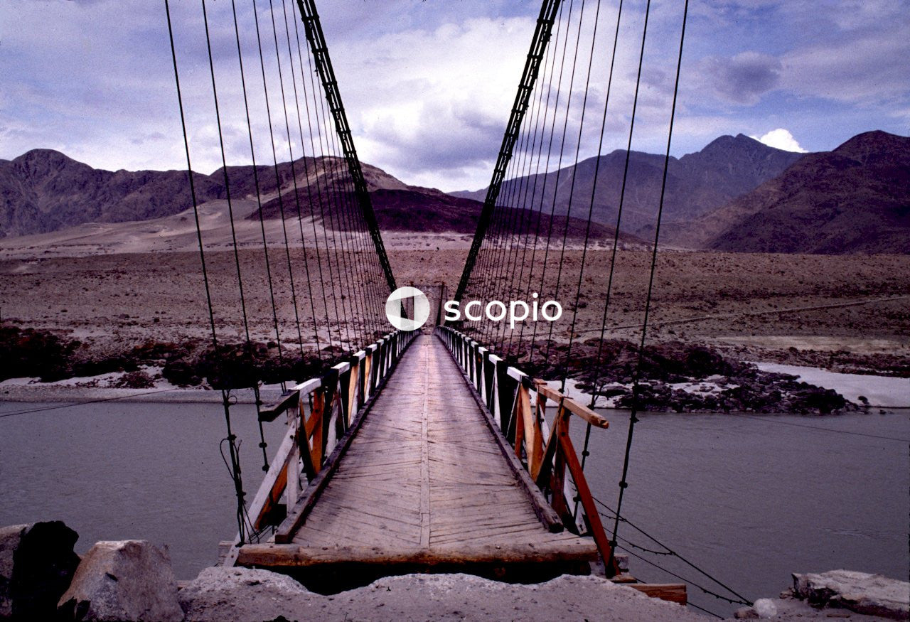 Brown wooden bridge over body of water