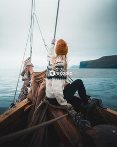 Woman sitting on boat on sea