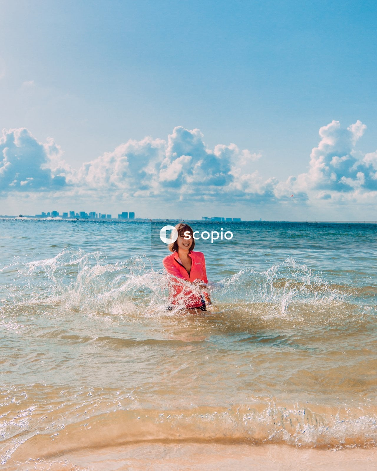 Woman in pink dress on beach