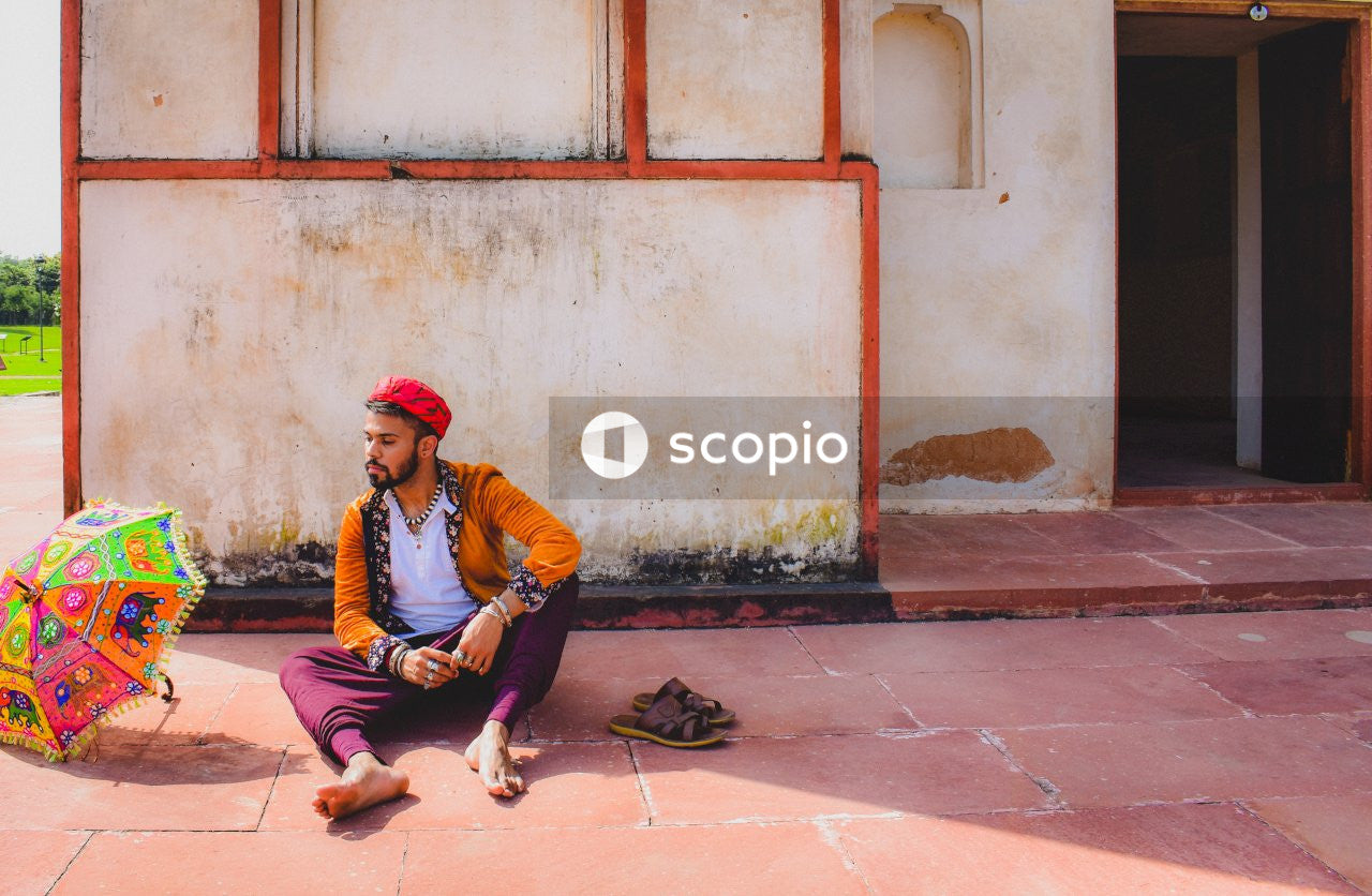 Man sitting outside temple