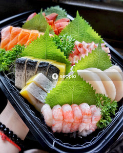 Assorted sushi in a black plastic tray