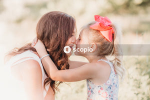 Girl kissing girls cheek