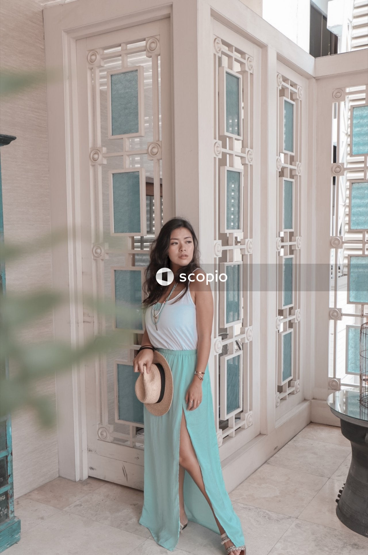 Woman wearing teal dress