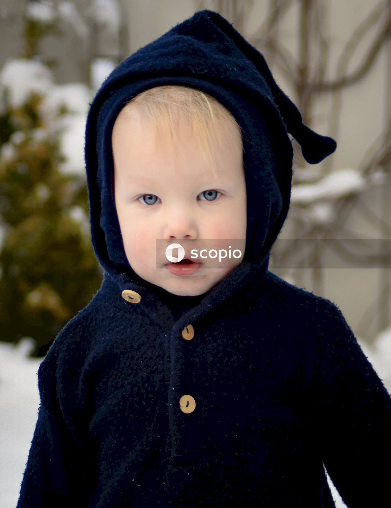 Baby standing on snow