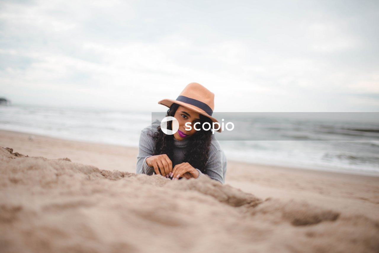 Portrait of young woman lying on beach