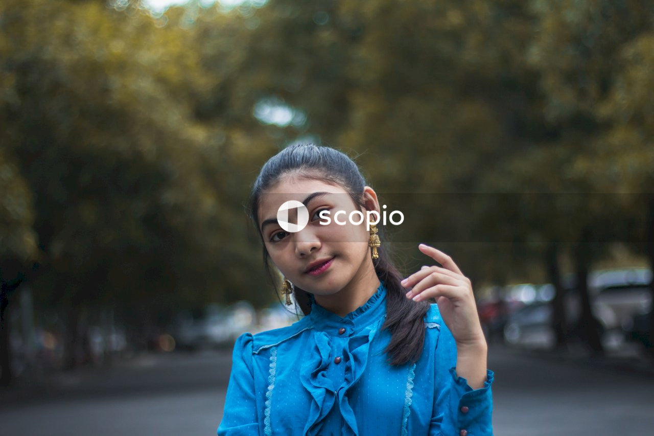 Woman in blue ruffled blouse