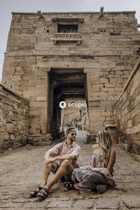 Man and woman sitting on brown concrete stairs