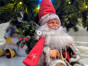 Santa claus doll under christmas tree
