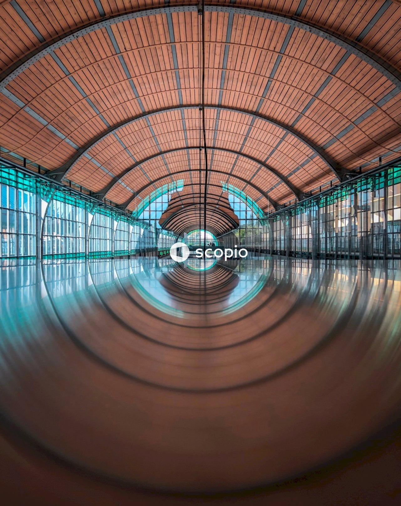 Wide angle photography of wide hall with floor reflection