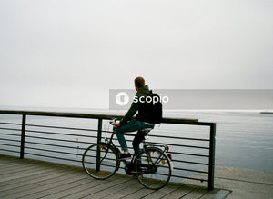 Person riding bike near body of water