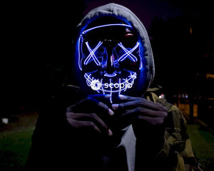 Person in black and blue mask