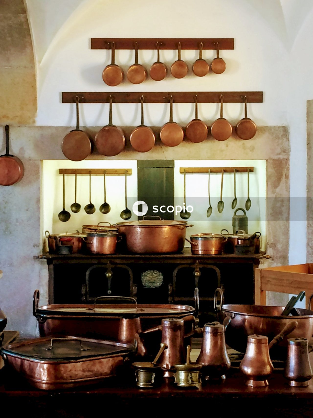 Brass-colored-and-black cooking pots and pans set