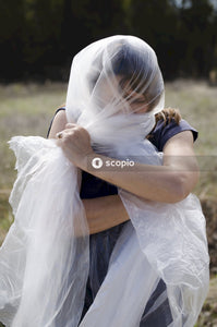 Woman covering own face