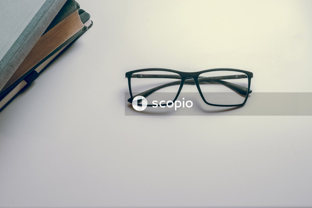 Black eyeglasses by books