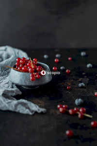 Red berries on gray round bowl
