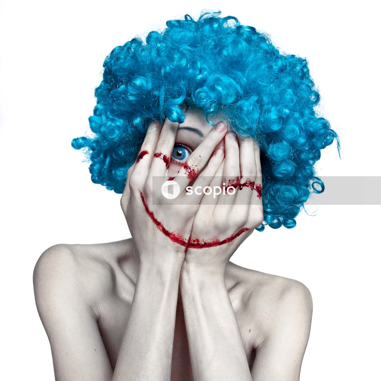Woman with purple hair holding her face