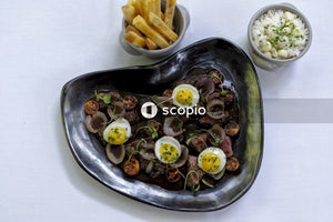 Seafood delicacy with sunny side-up eggs in bowl
