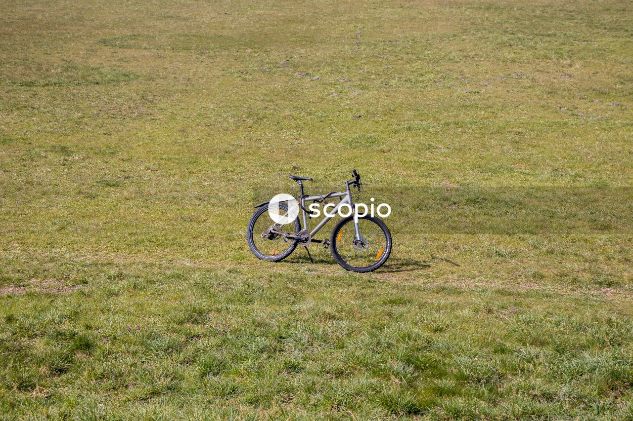 Black and white bicycle on green grass field
