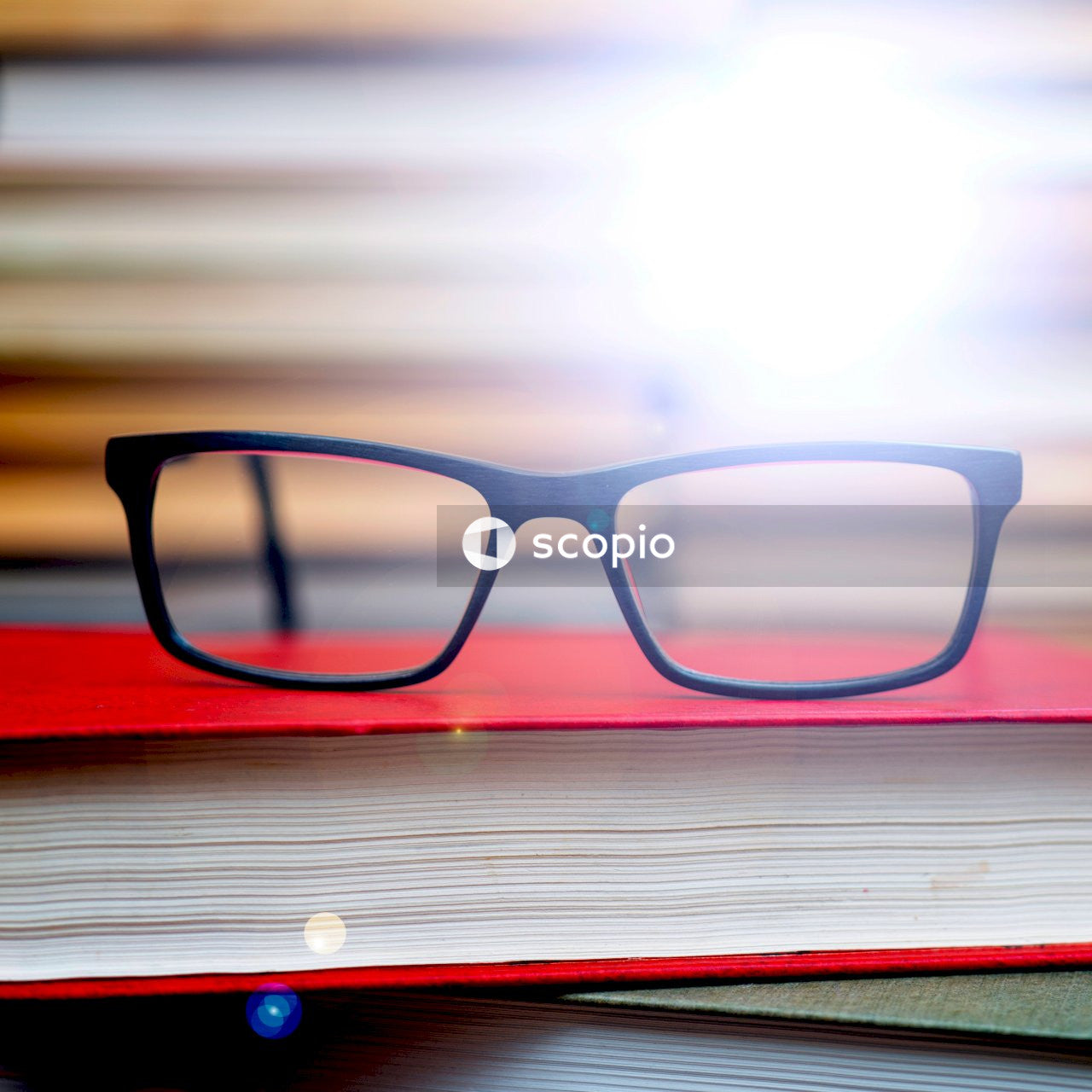 Black framed eyeglasses on red and white striped textile