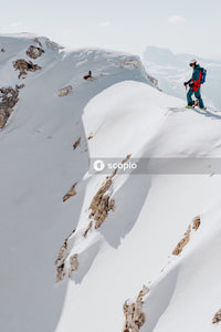 Photography of man standing on top snow-capped mountainitme