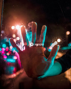 Persons hand with blue light