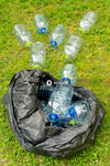 Clear plastic bottle on green grass