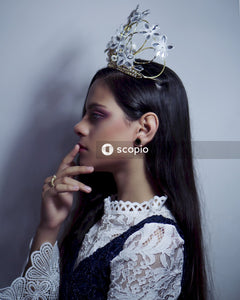 Woman wearing silver-color crown