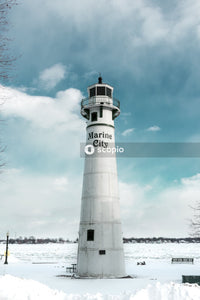 White and black lighthouse under blue sky
