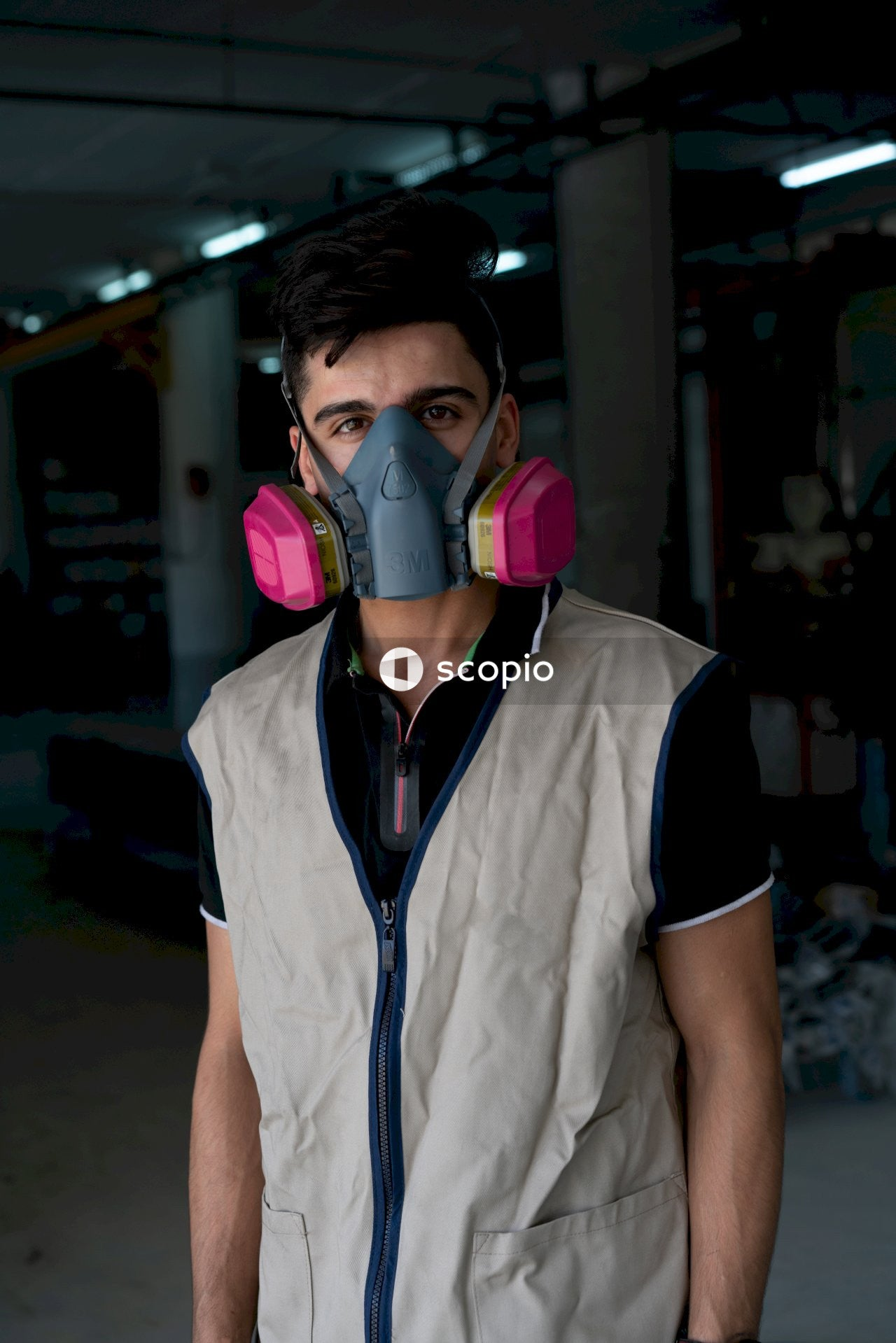 Portrait of a worker in a gas mask