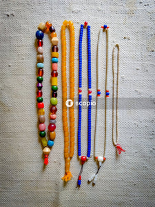 Multi colored beaded necklace on gray textile