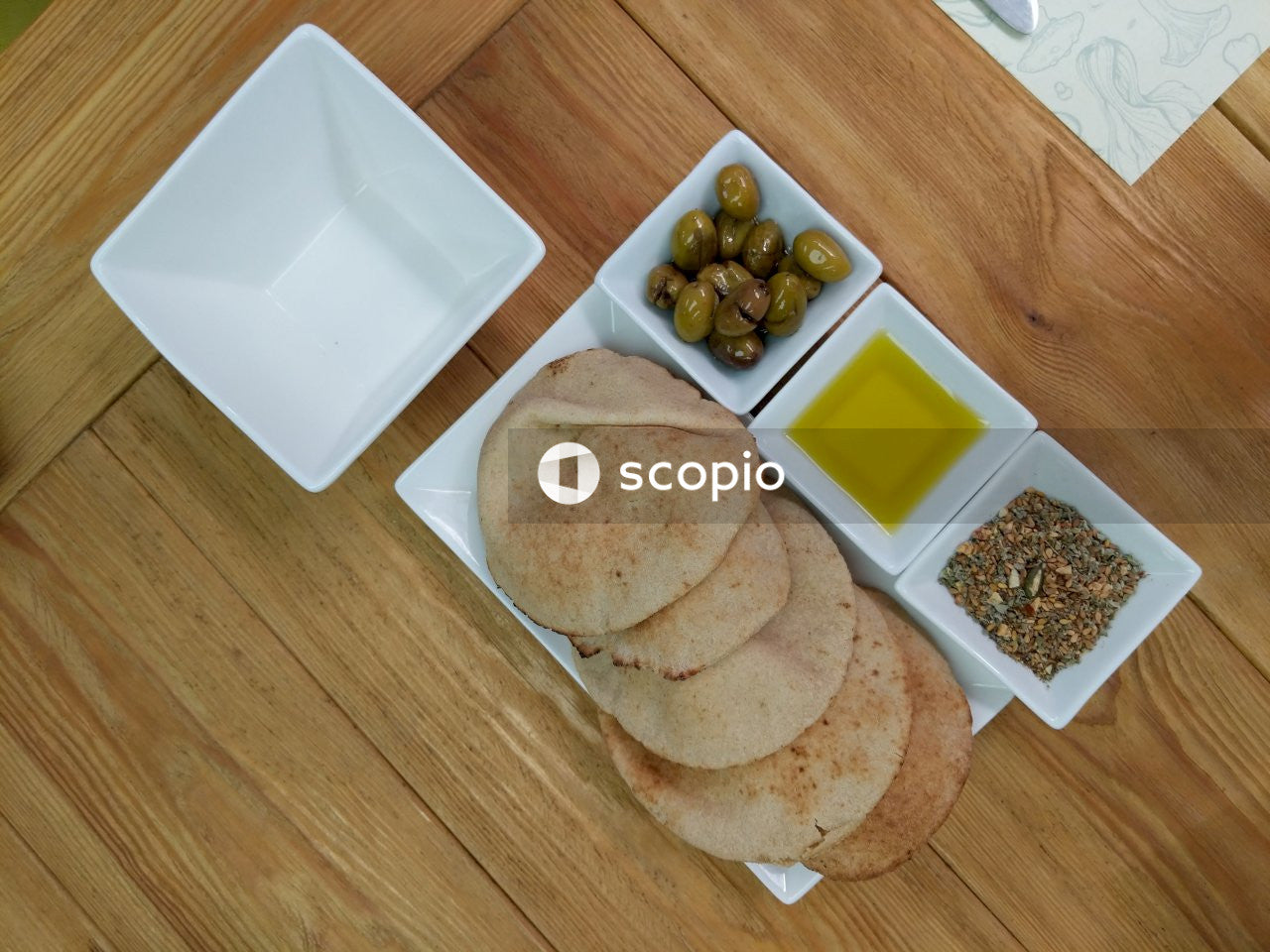 Pita breads on white ceramic plate
