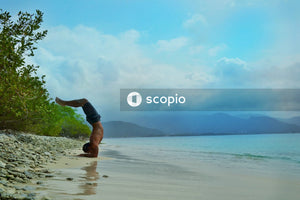 Man doing aerobics on seashore during daytime