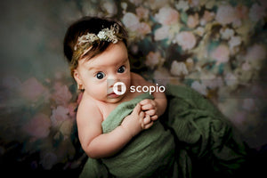 Girl in green dress with white flower headband