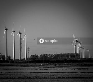 Grayscale photo of wind turbines