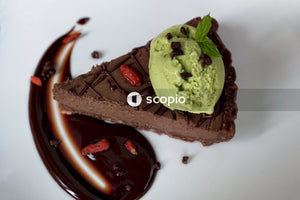 Green ice cream on brown chocolate cake
