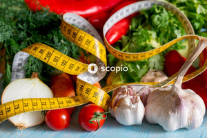 Vegetables and body measuring tape