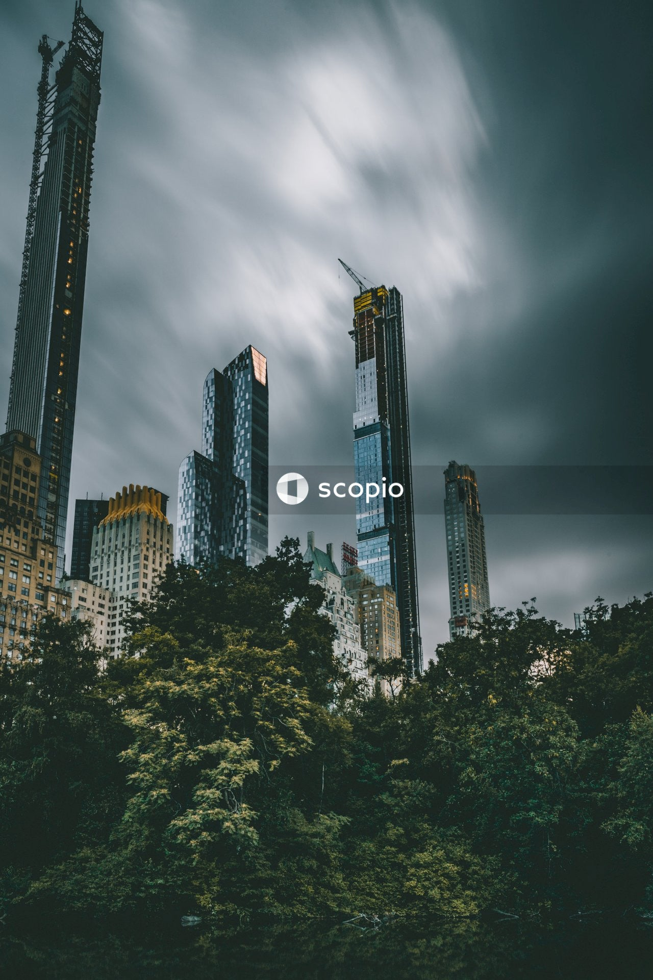 High rise buildings under gray clouds
