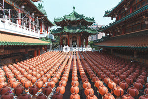 Orange pumpkins on red and green temple